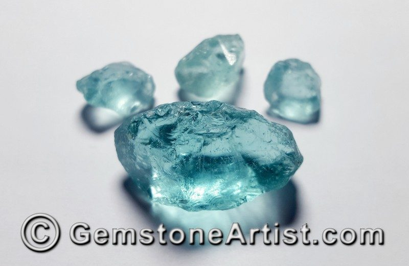 fake aquamarine facet rough scam